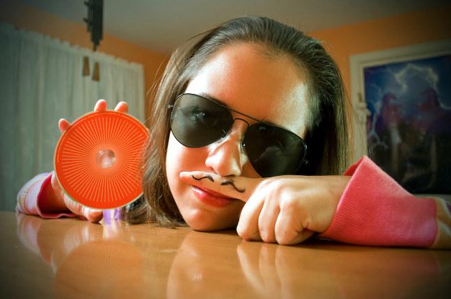 Weird girl holding a CD