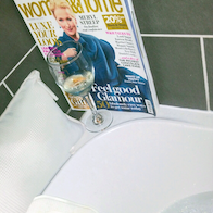 in the bath with woman and home  magazine