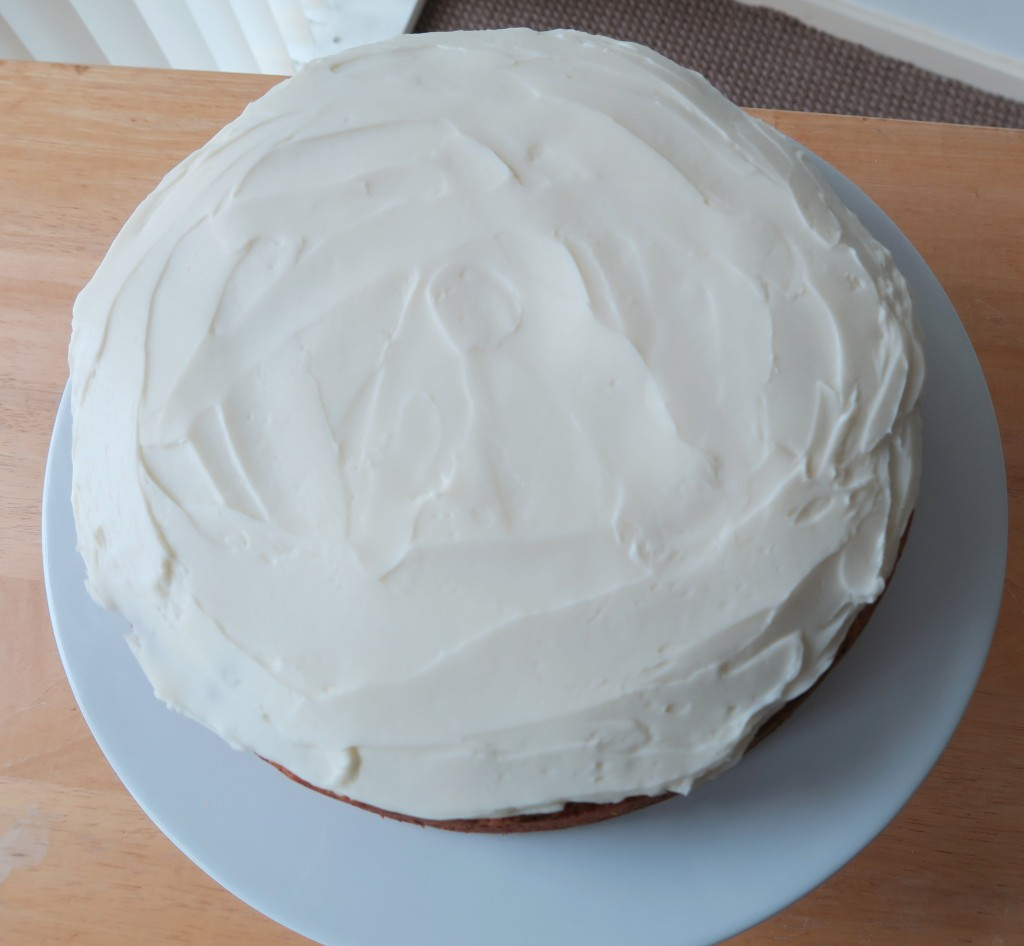Courgette cake covered in mascarpone cheese and icing sugar