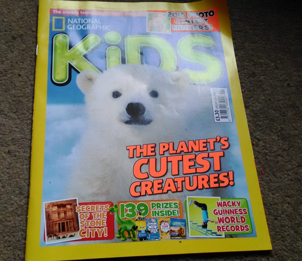 A baby polar bear on the cover of National Geographic Kids
