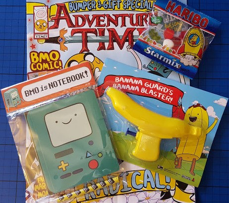 A selection of free gifts in Adventure Time magazine