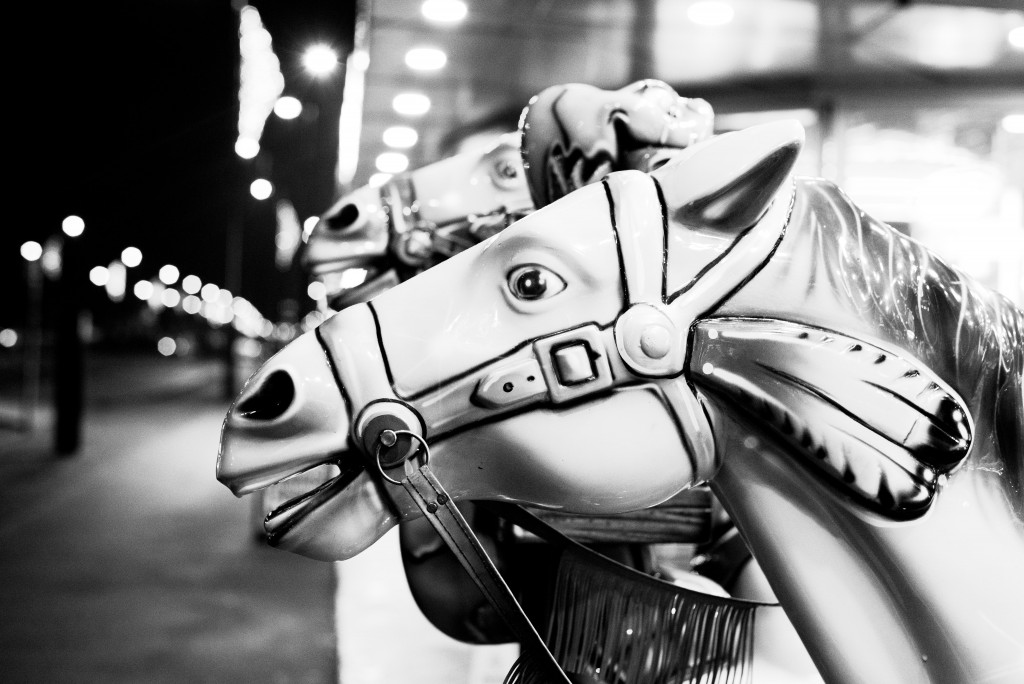 Black and white photograph of fairground horses