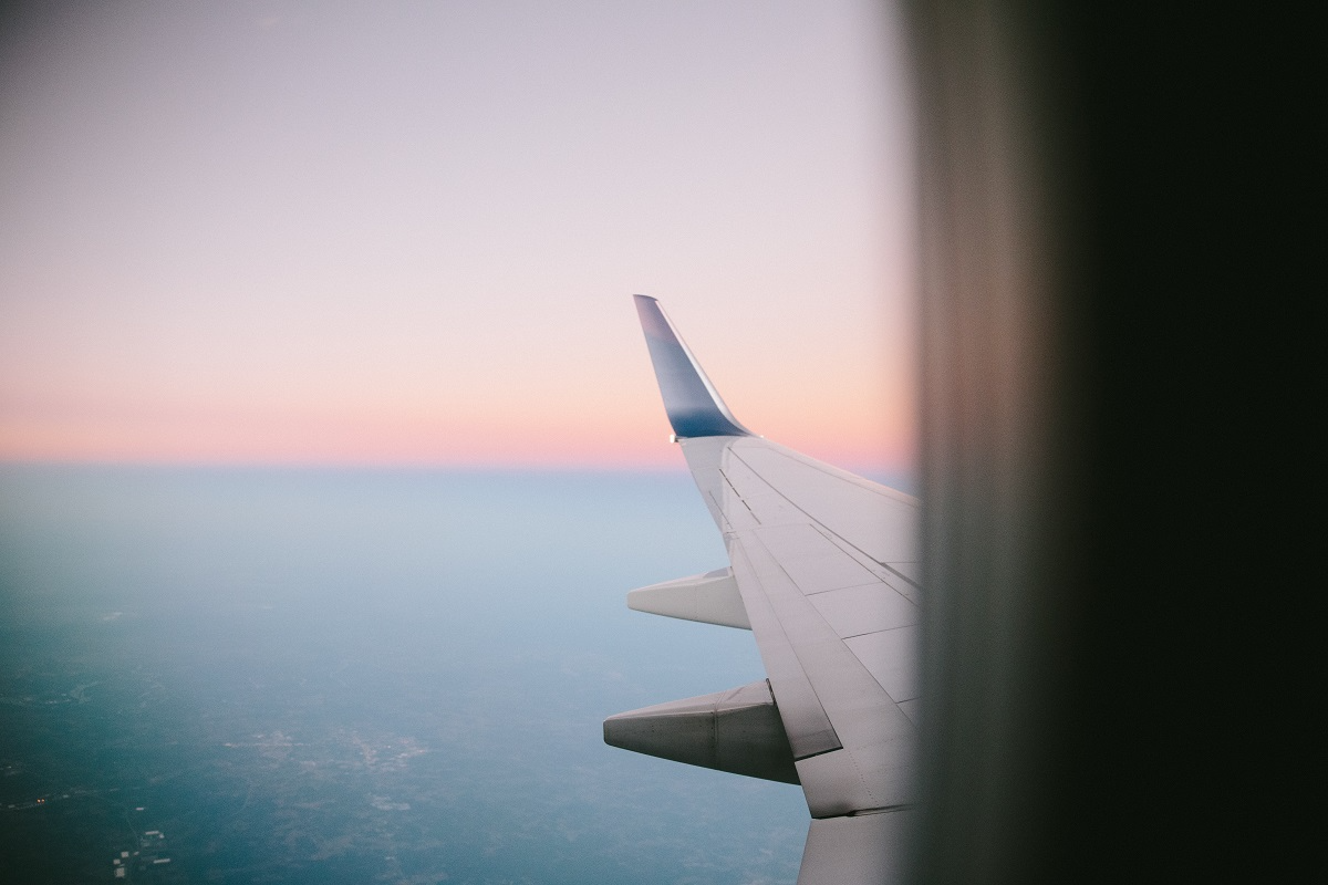 Plane Window photo by Freddy Castro on Unsplash